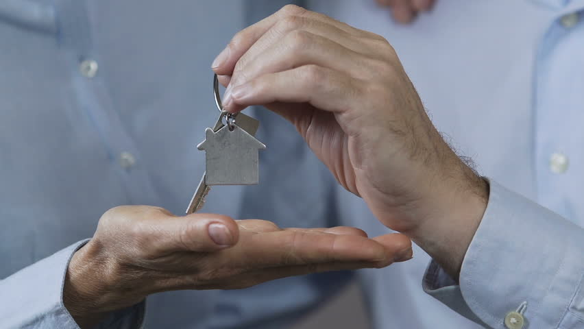 Family showing keys from new apartment, family loan fund, affordable housing | Shutterstock HD Video #33680737