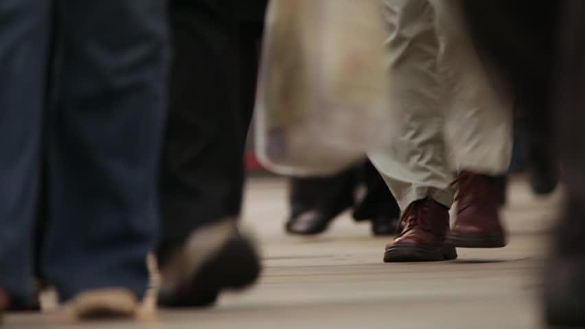 People's feet walking on the London Bridge