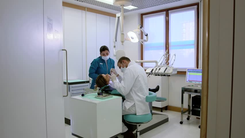 Health care in dental clinic, people working as dentist and medical assistant, checking hygiene of female client. Sequence of steadicam wide and medium shots #3393404