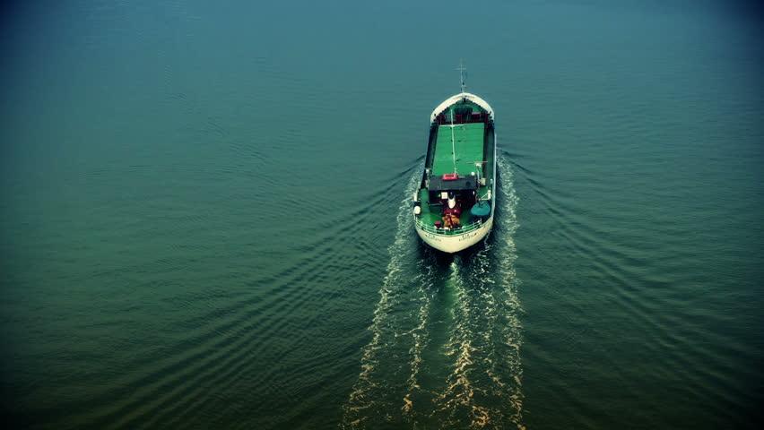 Cargo ship sailing away