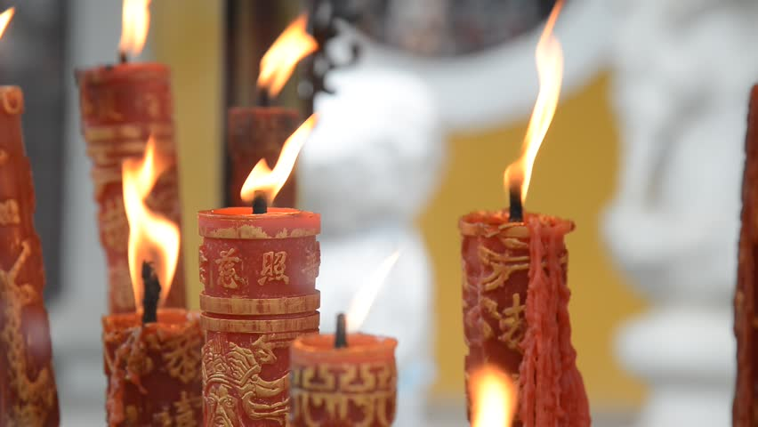 People light candles and incense in Xuedou Temple