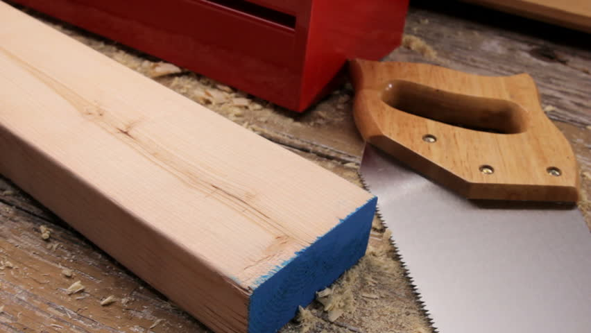 measuring 2 x 4 with a tape measure