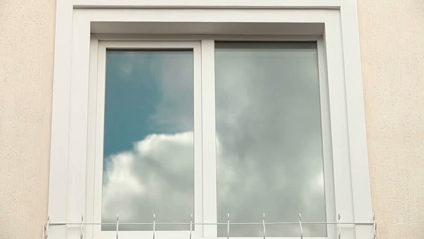 home exterior with cloud reflection in plastic window frame hd stock video clip