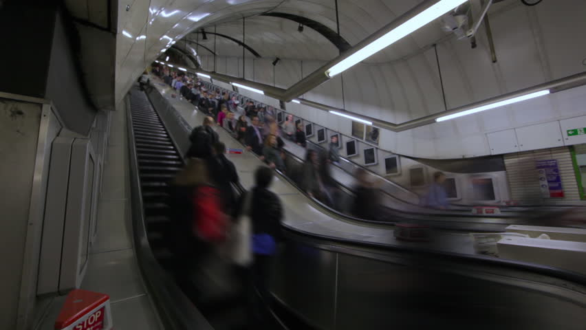 LONDON - OCTOBER 6, 2011: Time lapse of Escalators at Soho Station, London | Shutterstock HD Video #3463955