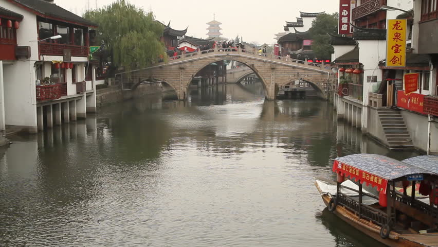SHANGHAI - DECEMBER 22: Qibao Ancient Town traditional bridge and wooden boat,