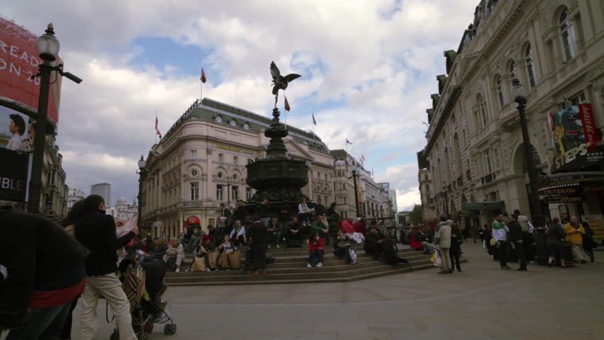 LONDON - OCTOBER 7, 2011: People standing and sitting around the Eros statue in