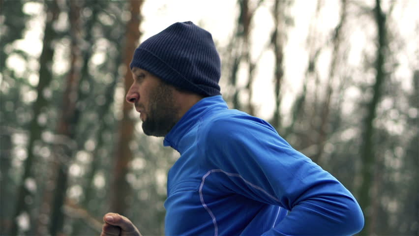 Lone runner in wintry wood, slow motion shot at 240fps