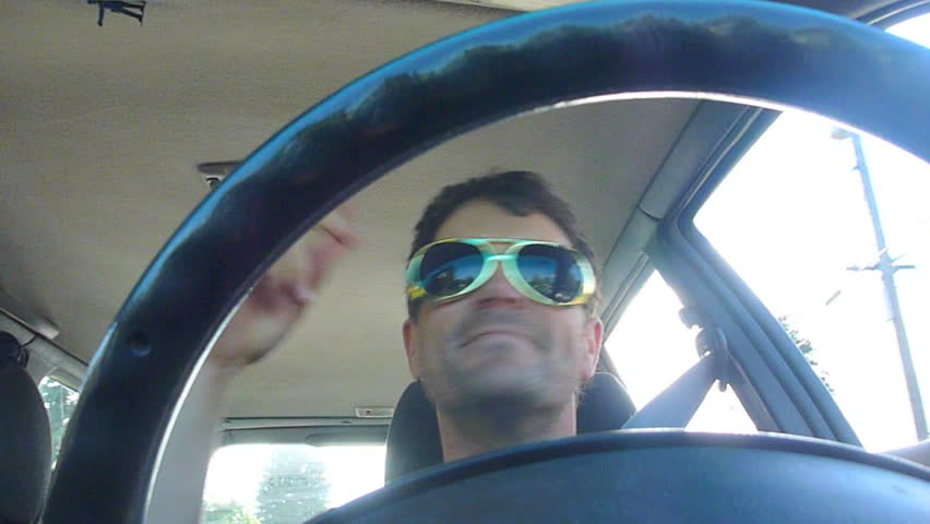 Funny clip series of model released man driving car, dancing and listening to