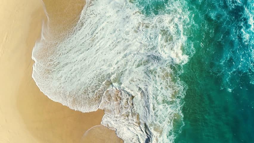 Aerial view waves break on white sand beach. Sea waves on the beautiful beach aerial view drone 4k shot. | Shutterstock HD Video #34903864
