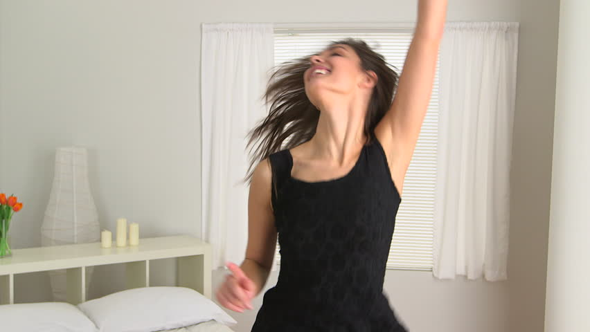 Young Caucasian woman dancing to the radio   HD stock footage clip. Carefree Young Caucasian Woman Dancing In Her Bedroom Stock