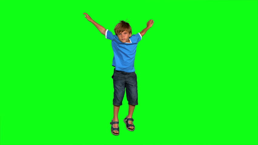 Boy jumping on green screen in slow motion