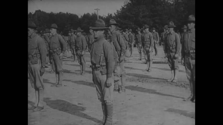 CIRCA - 1918 - Soldiers in training practice hand grenade throwing form and setting up machine guns, during WWI.