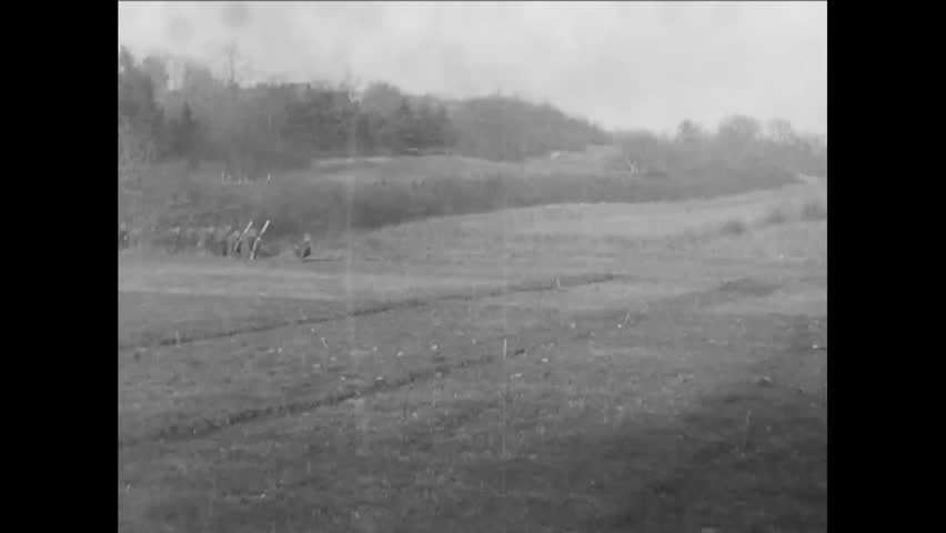 CIRCA - 1918 - Soldiers in the 42nd Division practice charging, shooting from trenches, and throwing hand grenades during training in France in WWI.