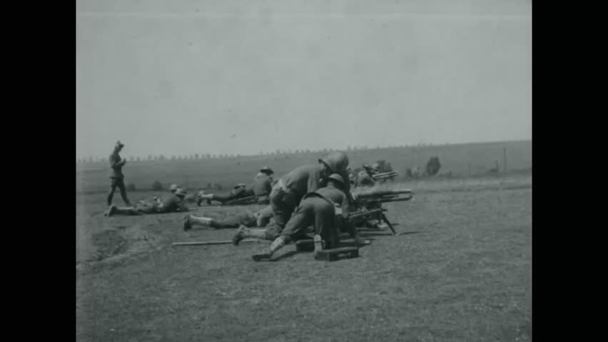 CIRCA - 1918 - Soldiers of the 80th Division practice using mortar guns, hand grenades, gas masks, and fortifying trenches