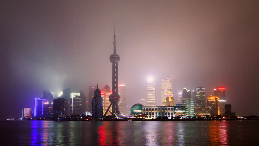 Time lapse of Shanghai skyline in drizzle night - Shanghai, China.