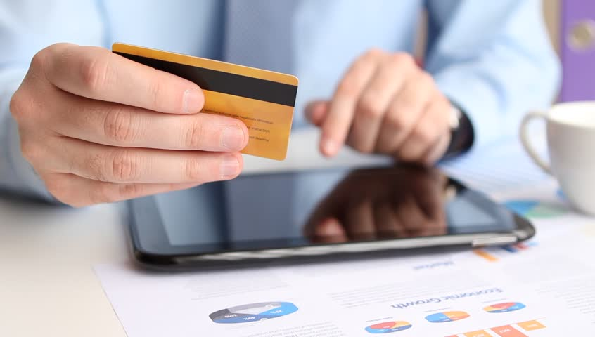 Shopping online with credit card on digital tablet