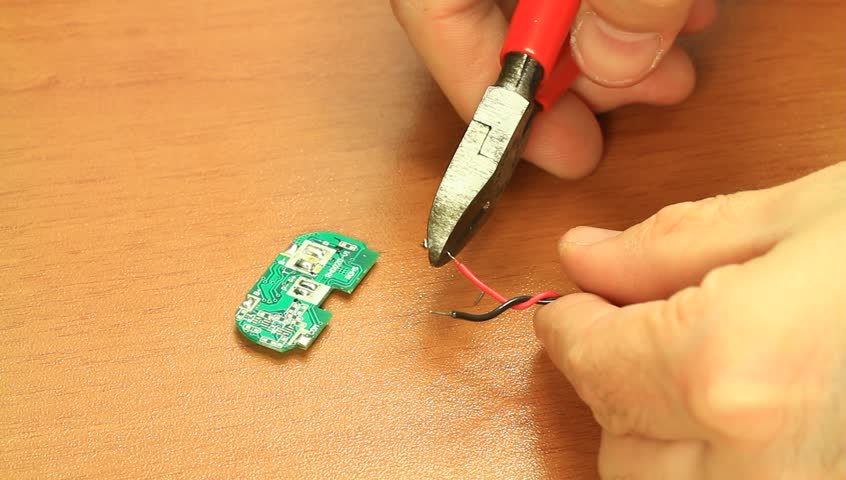 Electrician cutting cables end. Electrician cutting the cable end using a