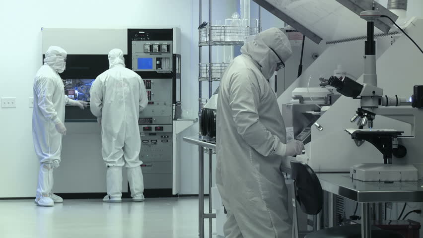 Clean Room Wide. Scientists / technicians working on silicon chip manufacture in