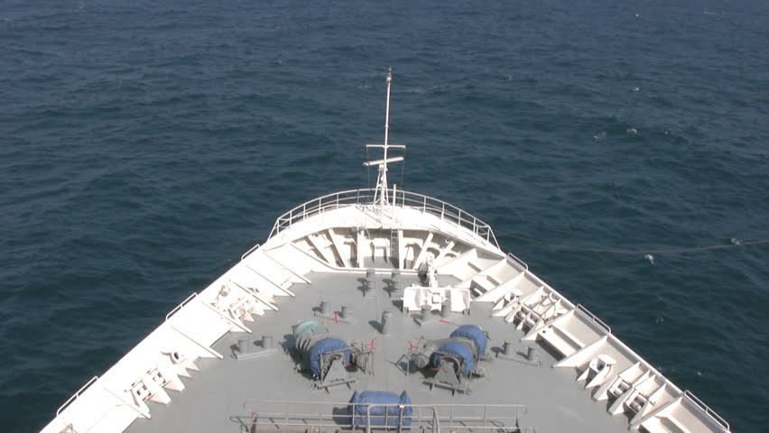 Top view of the bow of cruise liner, a cutting wave calm sea. Sunny