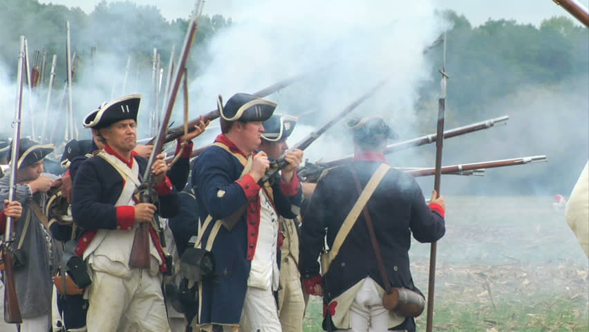 VIRGINIA - OCTOBER 2009 - large-scale, epic American Revolutionary War anniversary reenactment -- in the middle of battle.   Continental Army infantry volleys and fires in line of battle - Militia.