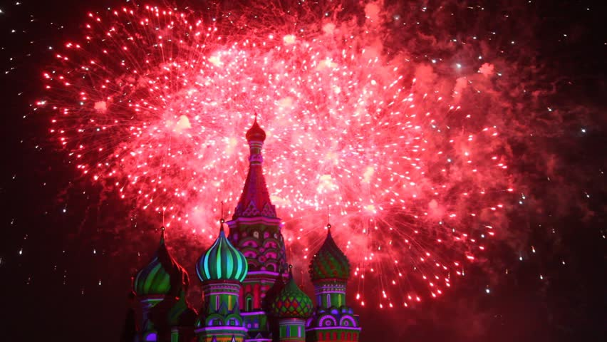 MOSCOW - AUG 31: Top of Saint Basil Church and sky illuminated by fireworks at Military Music Festival Spasskaya Tower, on Aug 31, 2011 in Moscow, Russia. #3622490