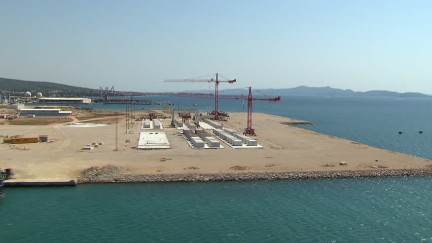 Aerial shot of red cranes in a Cargo Port