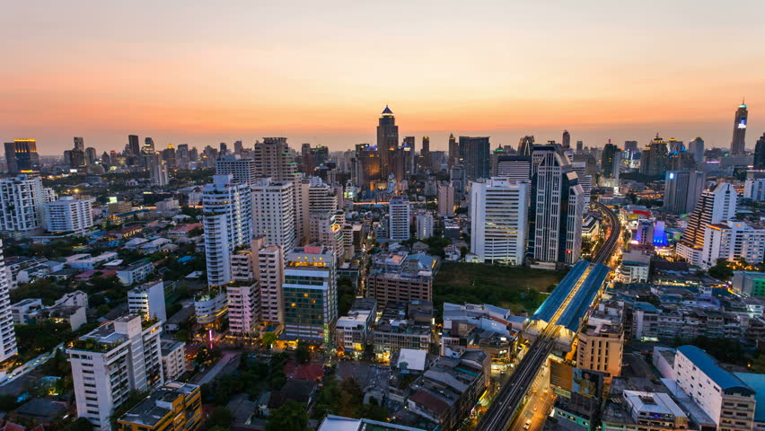 BANGKOK - 30 MARCH: Time lapse view of Bangkok skyline at sunset. Top view of