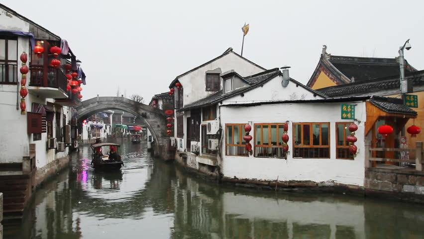 SHANGHAI - DECEMBER 20: Zhujiajiao traditional wooden boat sailing in the river,