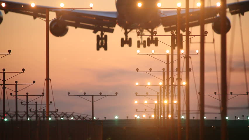 Big airplane plane landing in airport at sunset | Shutterstock HD Video #370123