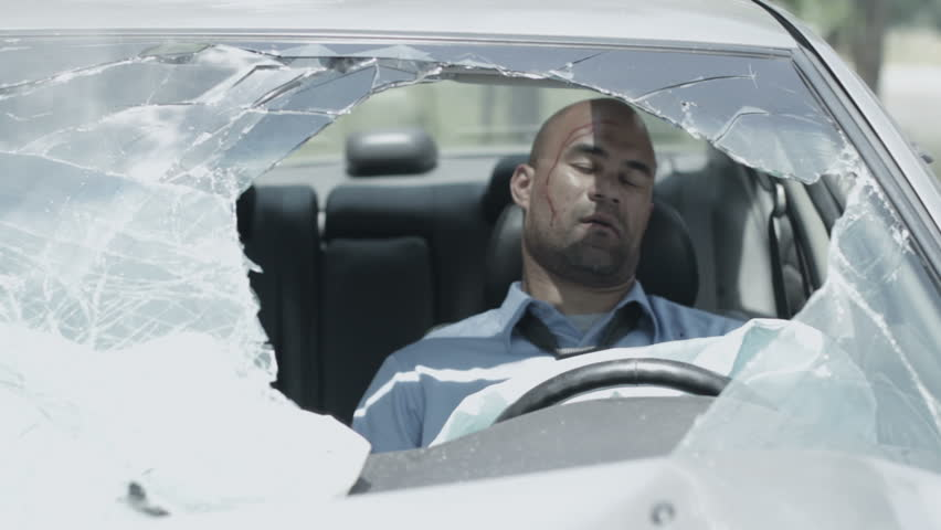 Driver regains consciousness and can be seen through the broken windscreen of