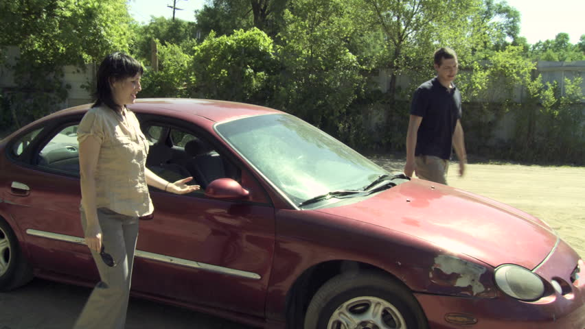 Couple get out of car and argue about who is to blame for an accident that