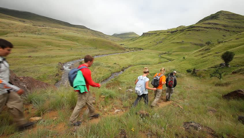 Young group hiking in the Drakensberg,  the highest mountain range in Southern