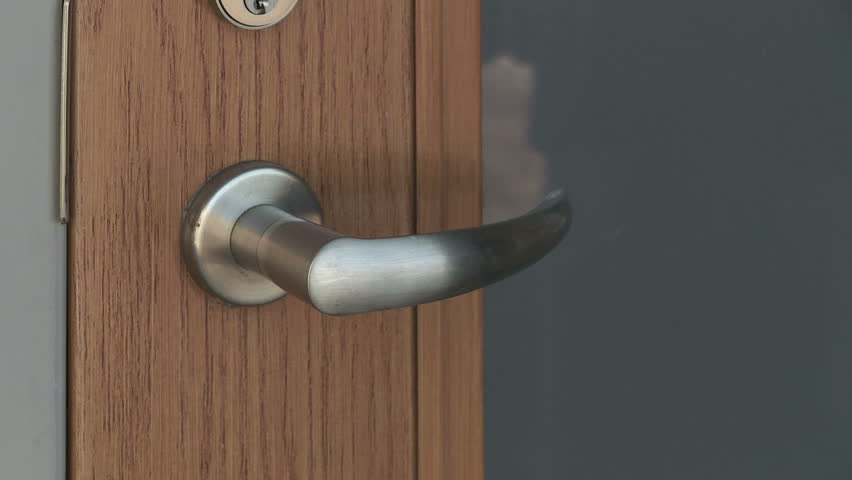Close up on a door handle as the door is opened. Symbol of new hope, fresh