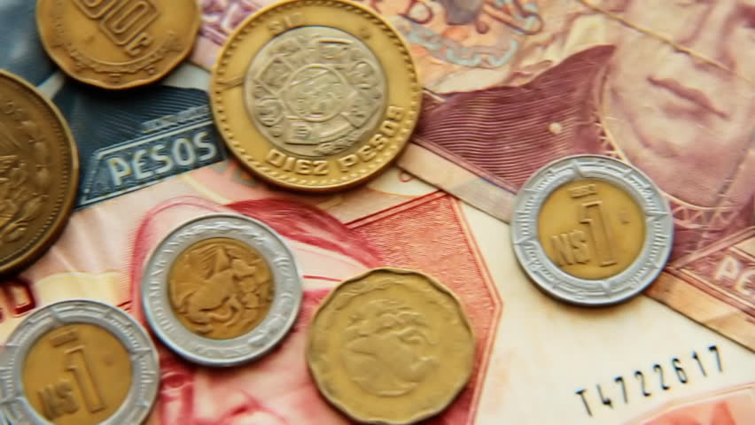Mexican Pesos 4. Mexican paper money and metal coin currency. Panning.