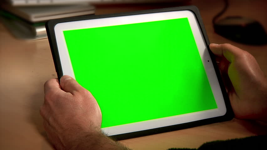 A man uses a tablet PC at his desk.  Chroma key screen for placement of your own content. | Shutterstock Video #3755555