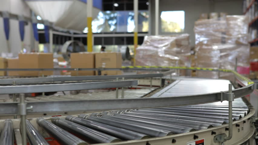 Boxes move along conveyor belt towards camera in time lapse sequence. Shot on Canon 5d Mk2 with a frame rate of 30fps