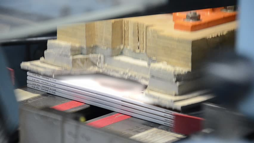 printed book production line into press plant house, final magazine cut