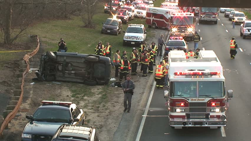 April 5, 2009 - Long Island, NY - Overturned Car Accident Scene on Highway with Fire Trucks and Police
