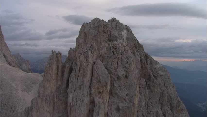 Flight over Mountains Peaks, Sunset, Flight above forest an mountains, Cineflex aerial, fly over rocks,