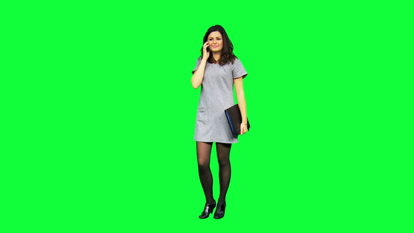Young female Caucasian business advisor portfolio using smart phone technology with green screen