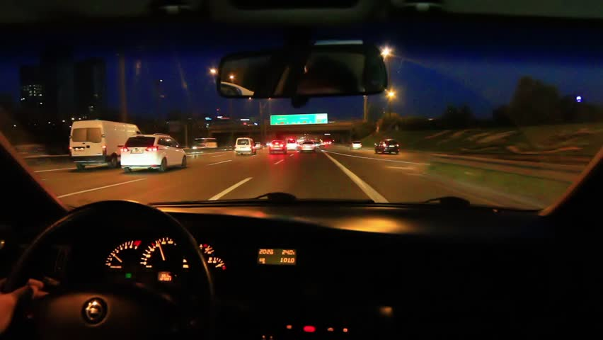 Freeway driving night. Driving from car interior.