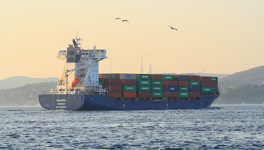 ISTANBUL - APR 27: Container ship CALISTO cruising northbound on the straits