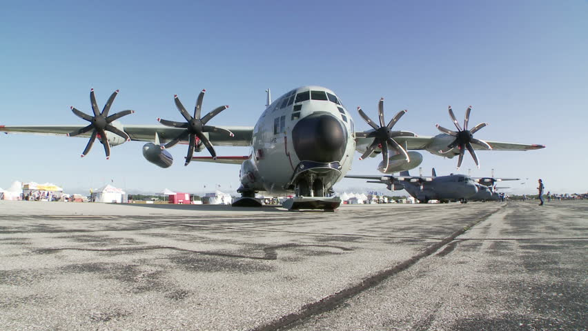 Lockheed Hercules military transport aircraft parked at an airshow.  Two clips