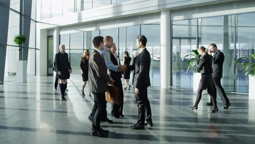 Confident and attractive young business team meet up with their client and shake hands, in a light and modern office building.  | Shutterstock Video #3870653