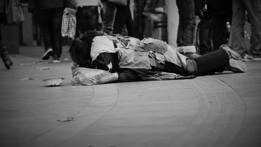 Homeless guy on the street, with dark vignette