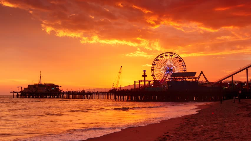 Sunset at Santa Monica beach pier, California. Zoom in on ferris wheel. HD Timelapse. | Shutterstock HD Video #3883388