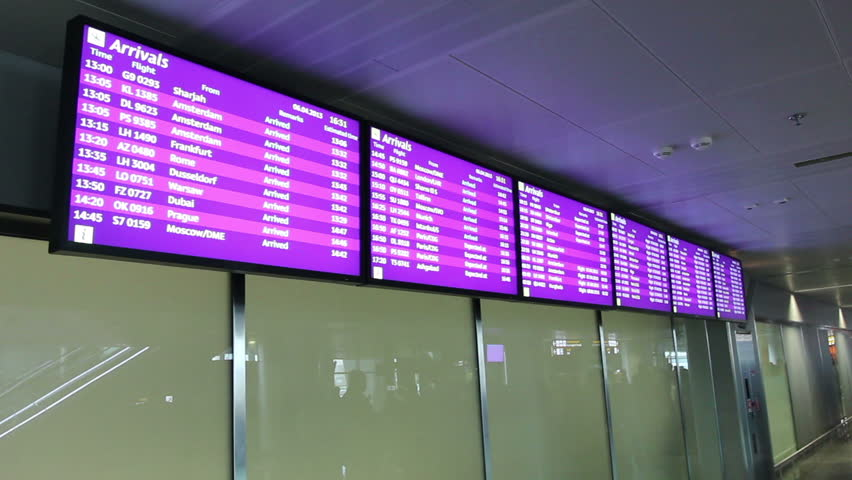 Information screens at airport lobby. Flight arrivals and departures screen