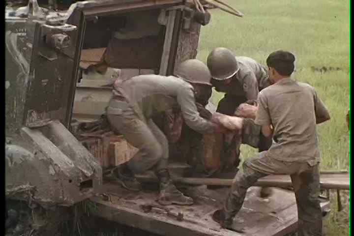 1960s - Battle footage and wounded victims of war in Vietnam.