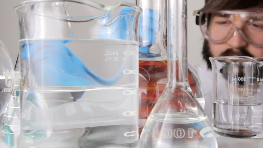 Scientist pouring biofuel in a lab