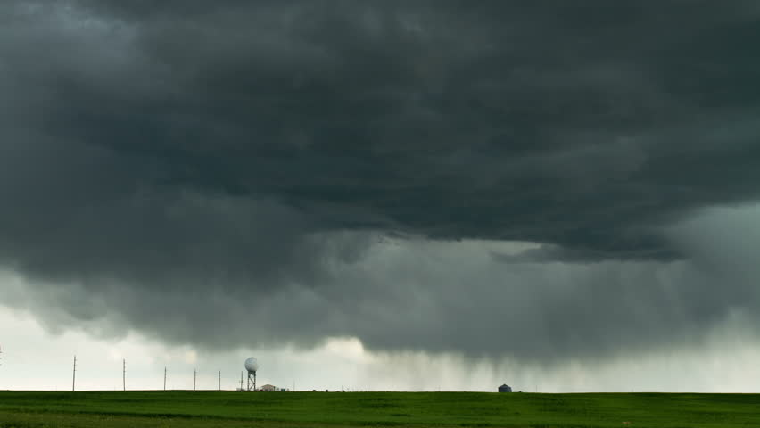 Massive thunderstorm moves over eastern Colorado, with churning storm clouds and